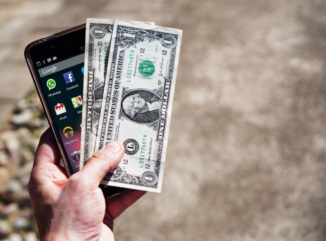 mobile-phone-money-banknotes-us-dollars-163069